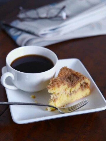 Gluten-free bisquick coffee cake next to a cup of coffee.