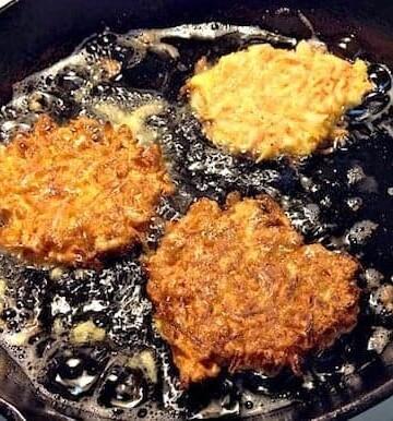 Gluten-free sweet potato latkes frying.