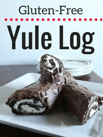 Gluten-free yule log on a white platter.