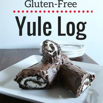 Gluten-free yule log on a white platter.