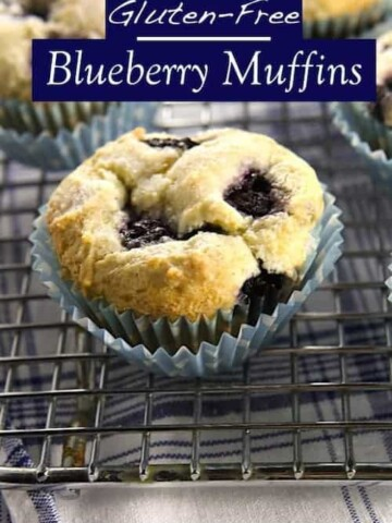 """Gluten-Free Blueberry Muffins on wire rack. Text on image reads """"Gluten-free blueberry muffins."""""""