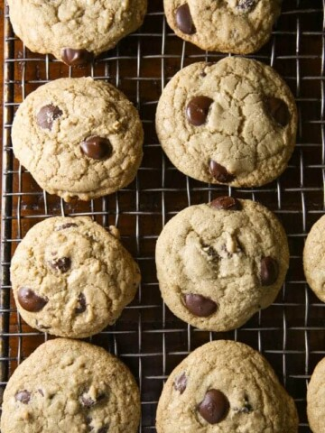 Gluten-free chocolate chip cookies on a cooling rack.