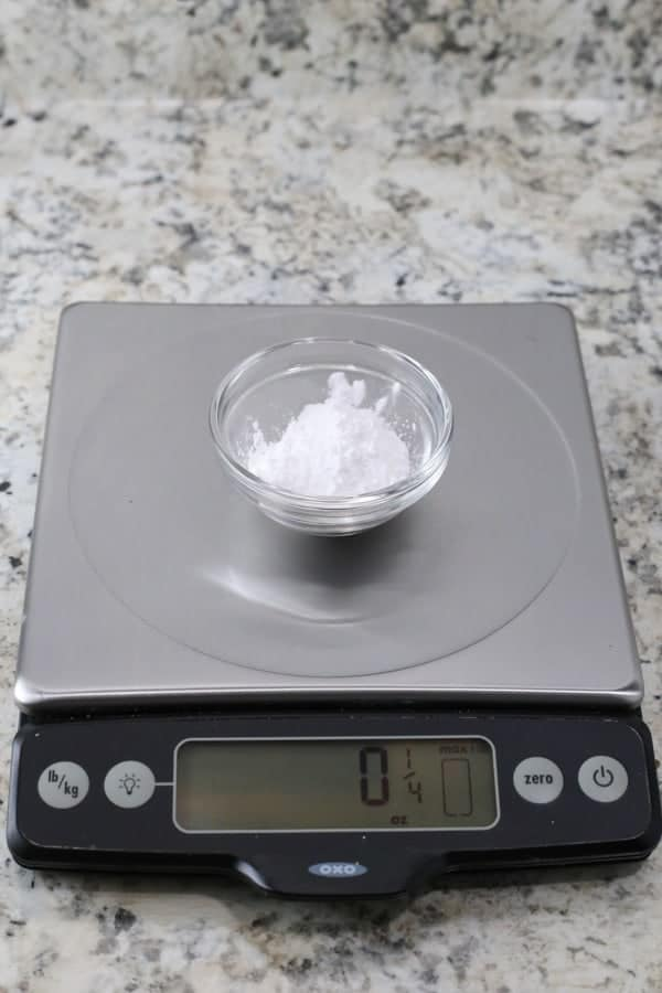 Tapioca starch on a scale. Digital display reads 1/4 ounce.