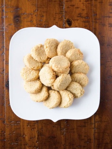 World's easiest almond cookies on white plate.