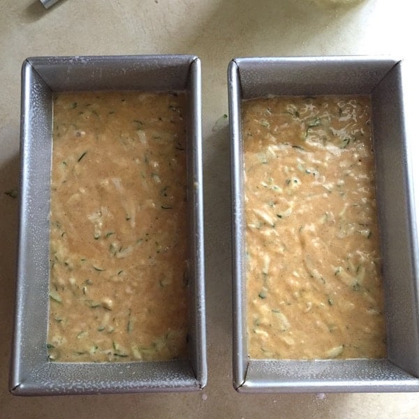 Gluten-free zucchini bread batter in two loaf pans.