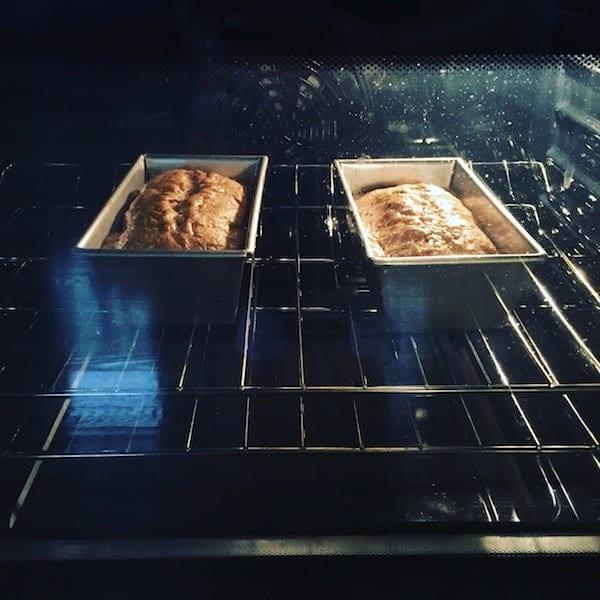 Gluten-free zucchini bread baking in oven.