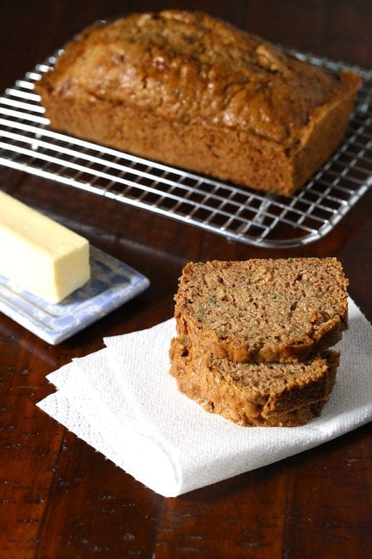 Gluten-free zucchini bread cooling on a wire rack.