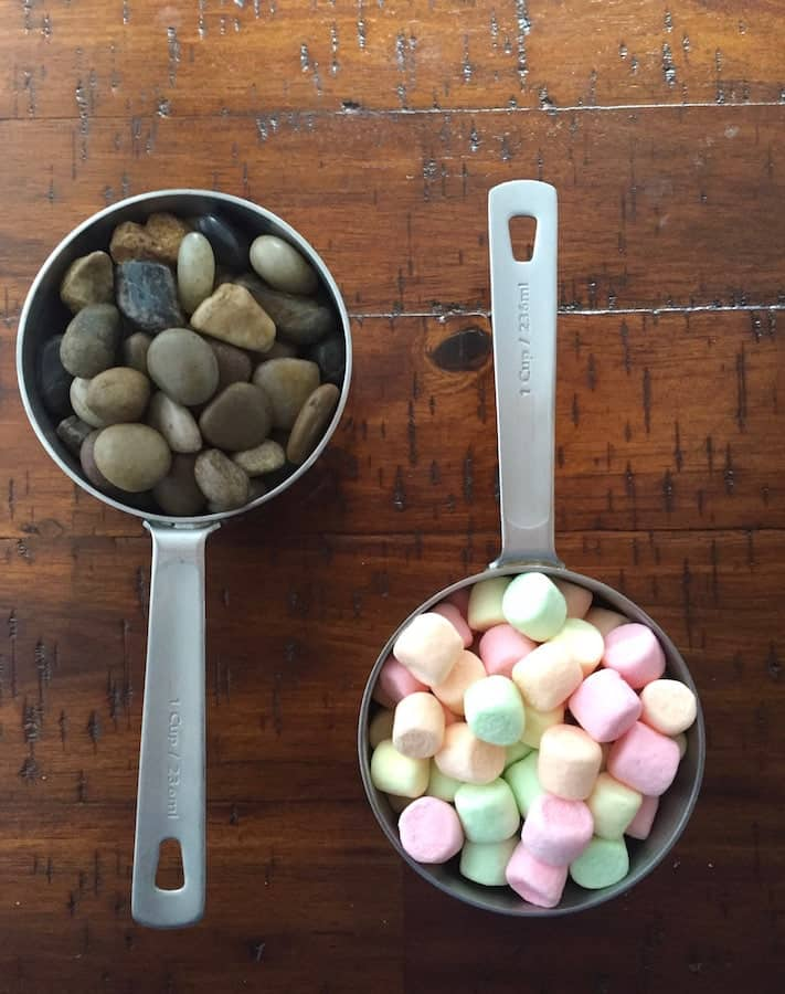 Measuring cup filled with stones (left). Measuring cup filled with colorful marshmallows. (Right)