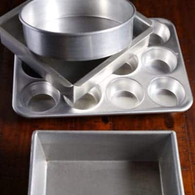 Different cake pans. Loaf pan. Muffin pan. Square cake pan. Round cake pan