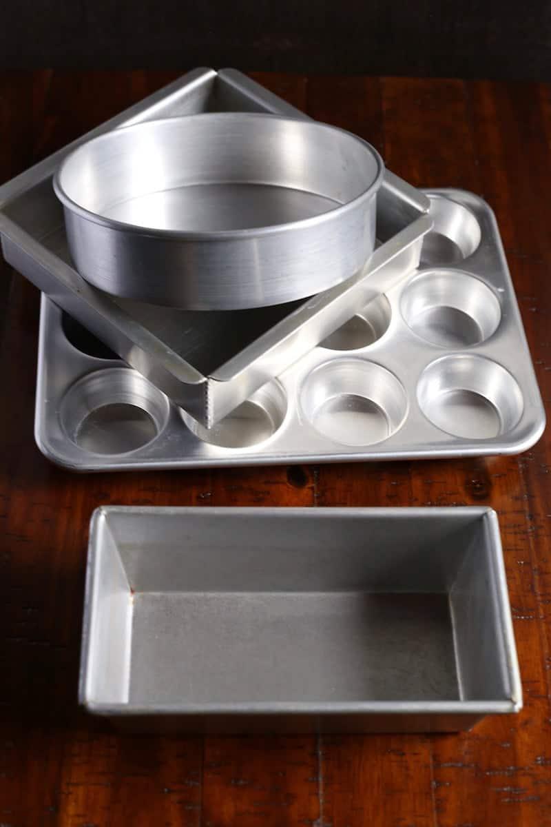 Different cake pans. Loaf pan. Muffin pan. Square cake pan. Round cake pan