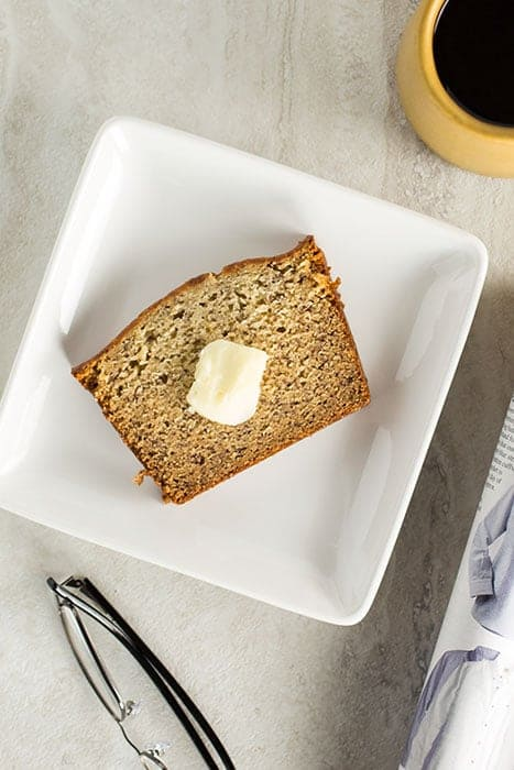 Slice of gluten-free banana bread on a plate.
