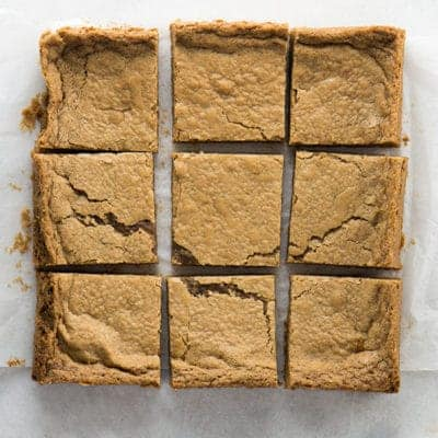 Gluten-free blondies cut on a marble board.