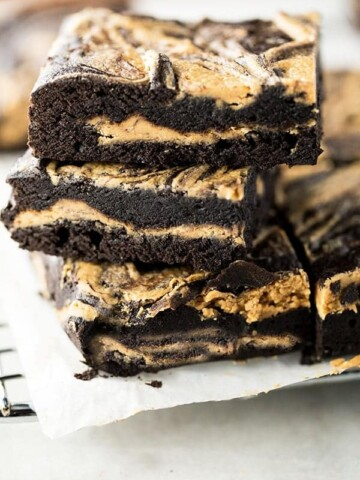 Stack of gluten-free peanut butter brownies.