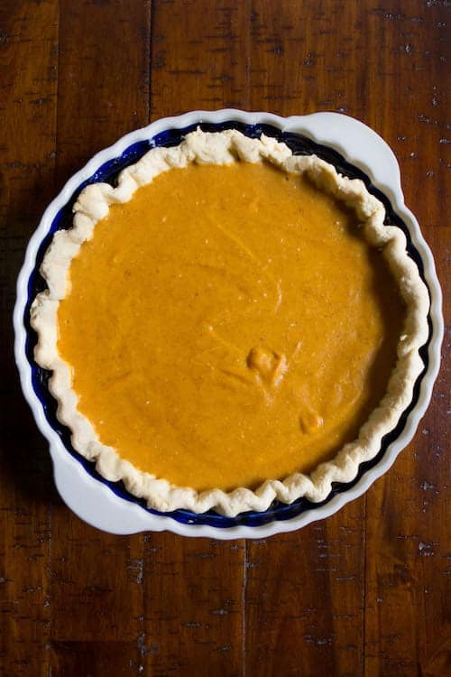 Egg-free, dairy-free, gluten-free pumpkin pie in pan.