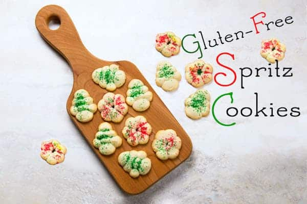 Gluten-free spritz cookies on cutting board.