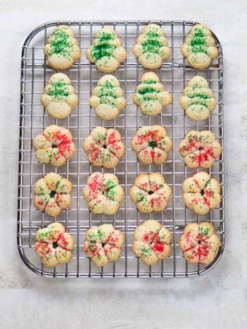 Gluten-free spritz cookies on wire rack.