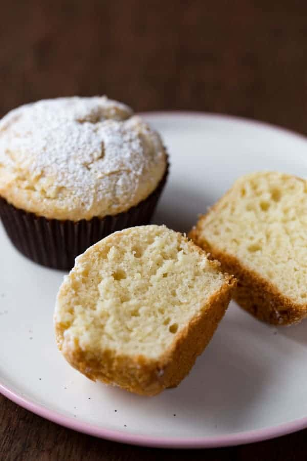 Gluten-free sour cream muffins on a white plate.
