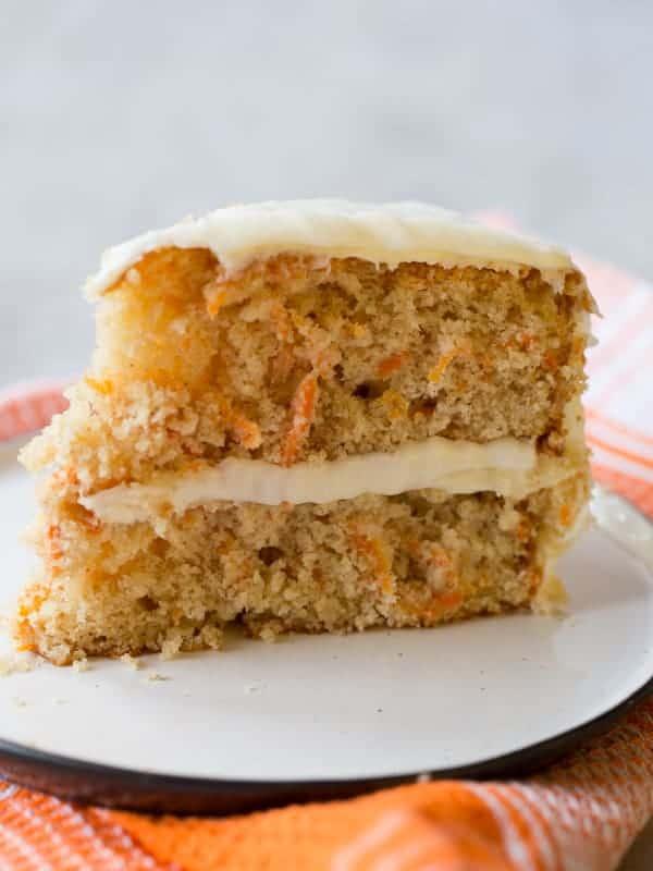 Slice of gluten-free carrot cake on plate.