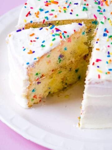 Gluten-free funfetti cake on white platter.