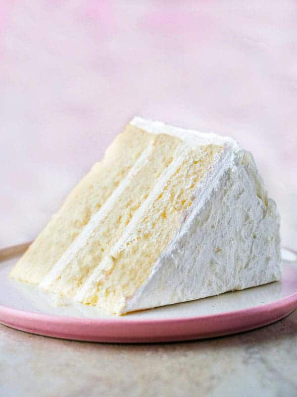 Gluten-free white cake slice on plate.