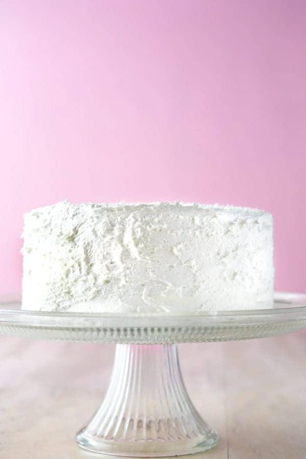 Gluten-Free white cake on cake stand.