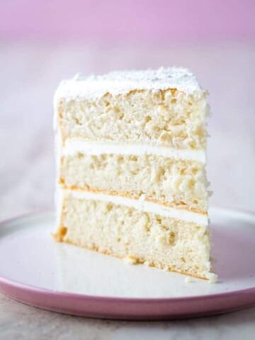 Slice of gluten-free white cake on plate.