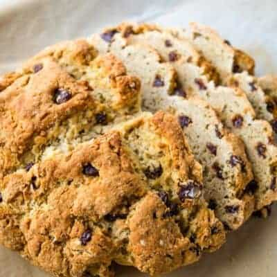 Sliced gluten-free Irish Soda bread with raisins and caraway seeds.