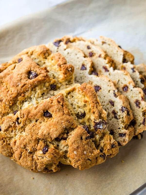 Slice gluten-free Irish Soda bread with raisins and caraway seeds.