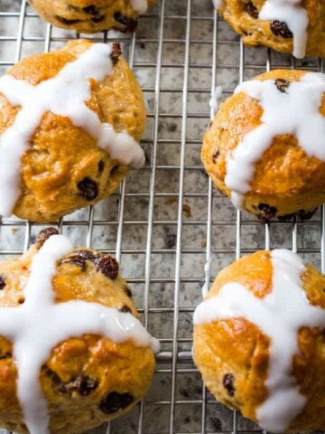 Baked Gluten-Free Hot Cross Buns on a Wire Rack.
