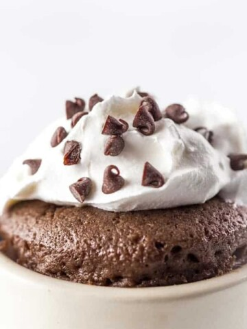 Gluten-Free Chocolate Mug Cake Closeup. Topped with Whipped Cream and Mini-Chocolate Chips