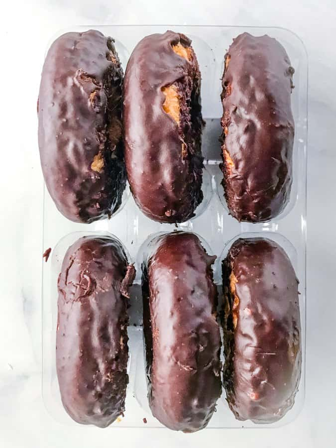 Six Aldi Gluten-Free Chocolate Frosted Doughnuts in Tray