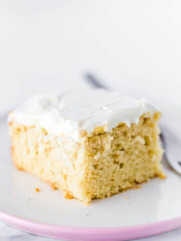 Slice of Gluten-Free Vanilla Sheet Cake on a plate.