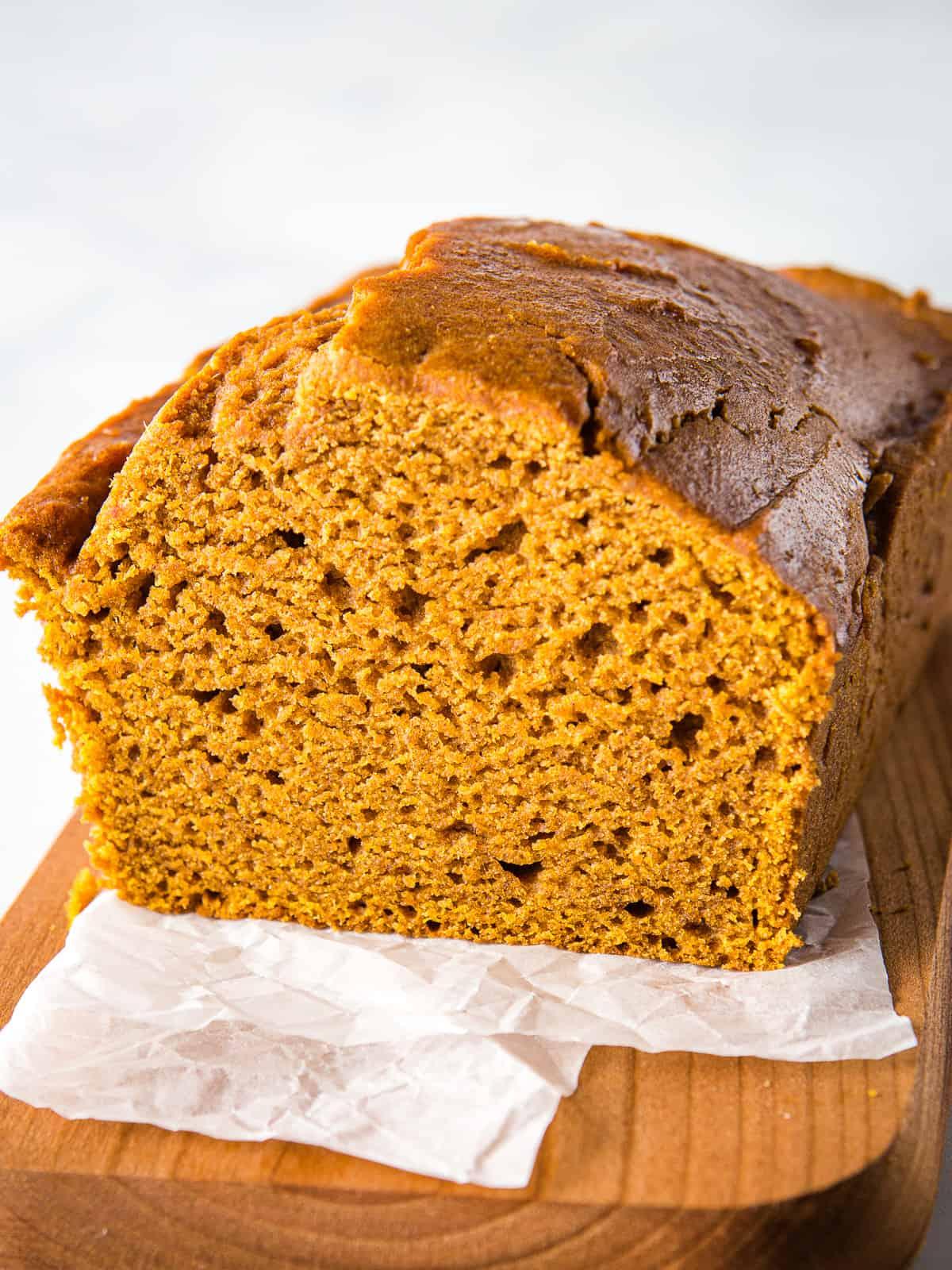 Gluten-Free pumpkin bread on a wood board.