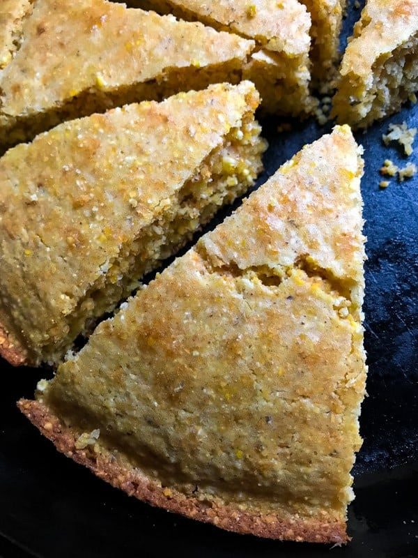 Gluten-Free Cornbread slices in cast iron skillet.