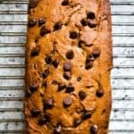 Baked gluten-free peanut butter banana bread on cooling rack.