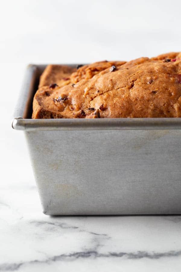 Gluten-free cranberry bread in pan.