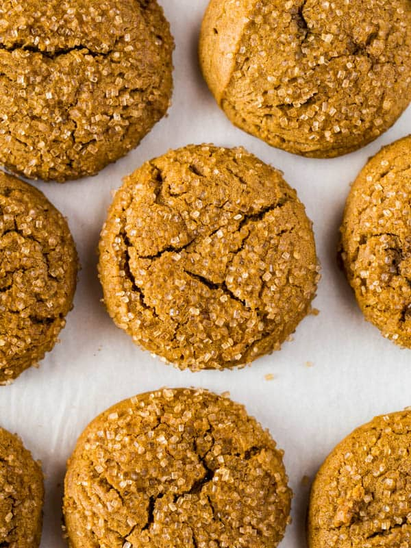 Baked gluten-free molasses cookies on a sheet pan.