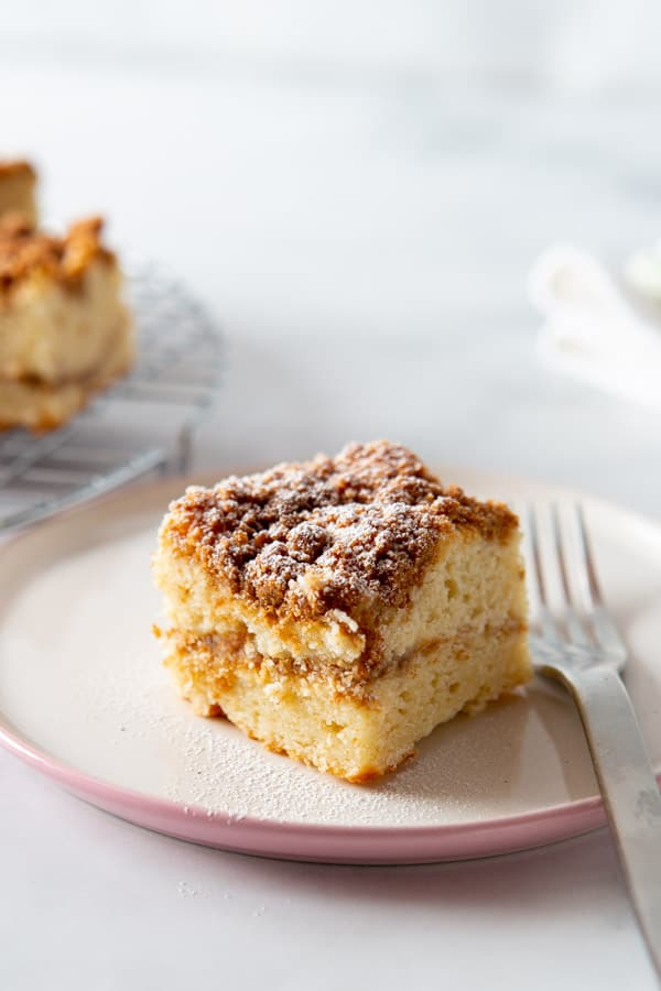 Slice of gluten-free coffee cake on a plate.