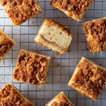 Squares of baked gluten-free coffee cake on a wire rack