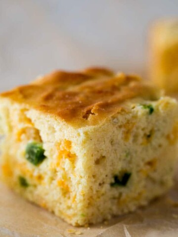 Slice of Jalapeno cornbread on brown parchment paper.