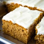 Gluten-free spice cake in pan with cream cheese frosting.