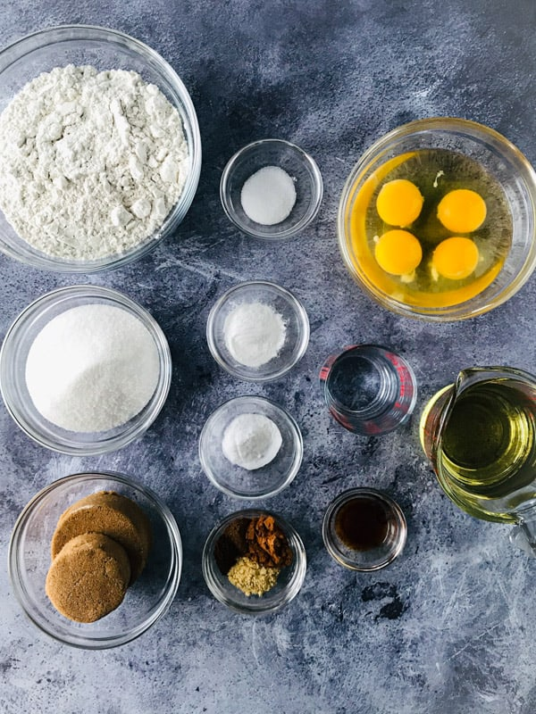 Ingredients in bowls for gluten-free spice cake.