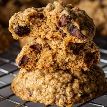 Stack of baked gluten-free oatmeal cookies with chocolate chips.
