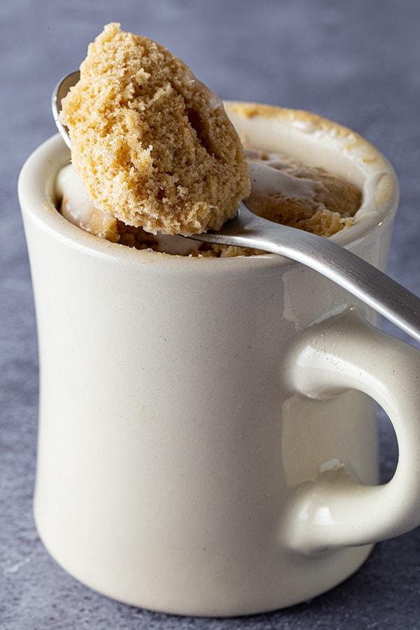 White mug with gluten-free spice mug cake