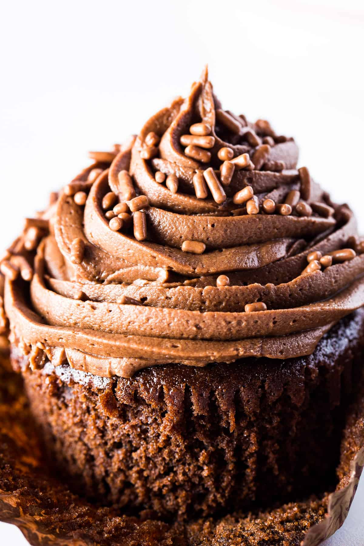 Gluten-free chocolate cupcake with chocolate frosting. Unwrapped from cupcake liner.