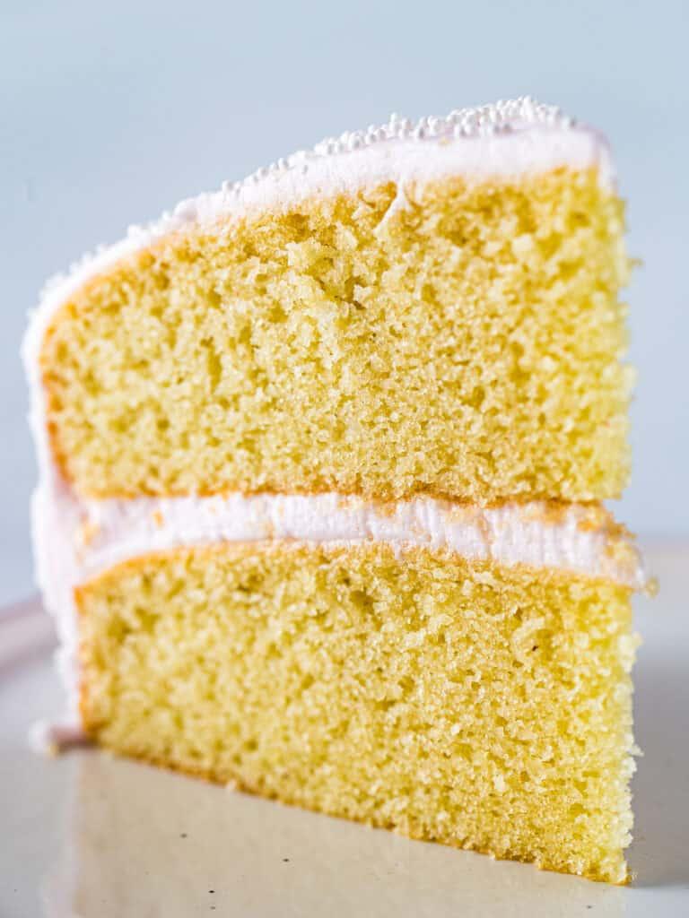Slice of almond flour cake on a plate.