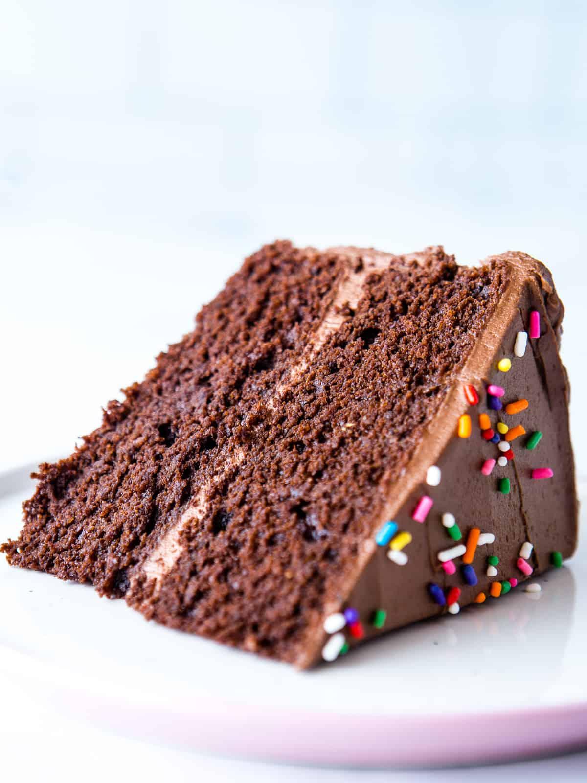 Slice of almond flour chocolate cake on a plate.