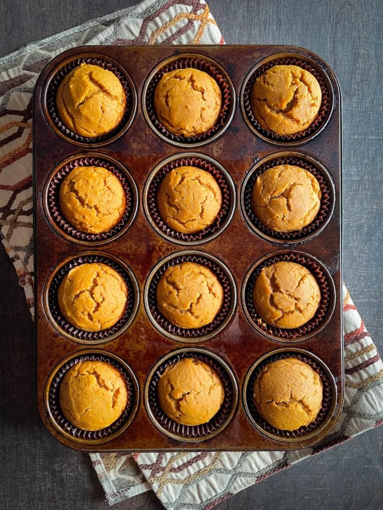Gluten-free pumpkin muffins baked in a muffin pan.