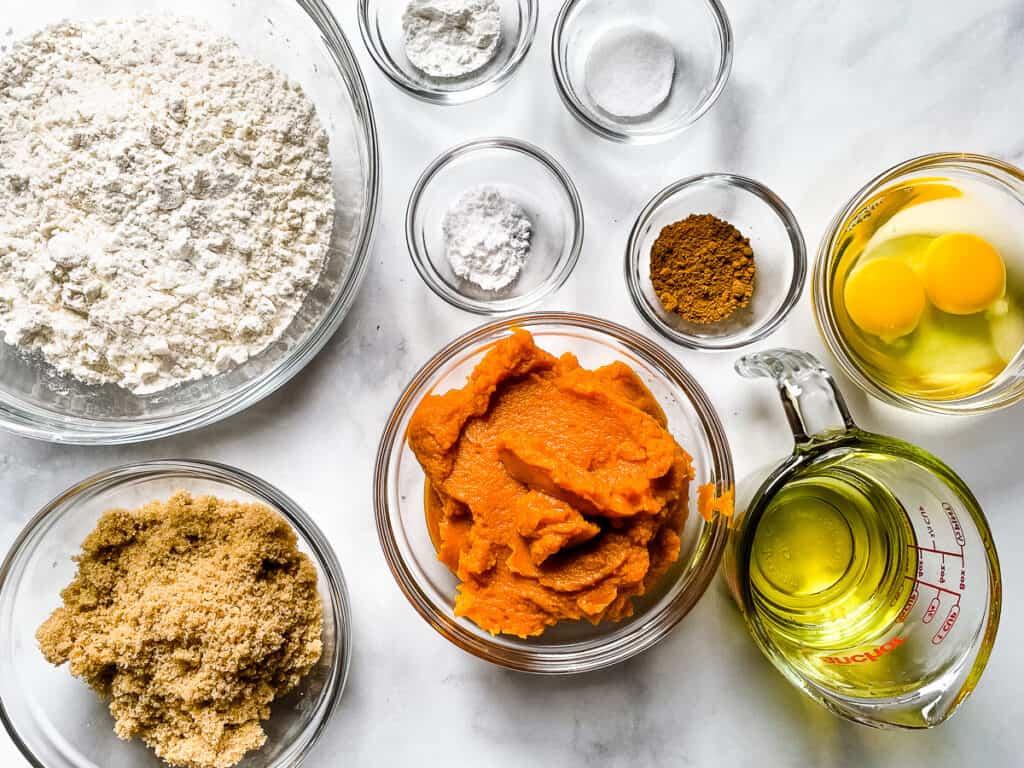 Gluten-free pumpkin muffin ingredients measured and in bowls.